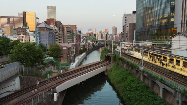 WS T/L Shot of day to night transition over Ochanomizu area / Tokyo, Japan