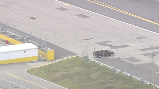 aerial ws shot of daytona international speedway / florida, united states - circuito di daytona video stock e b–roll