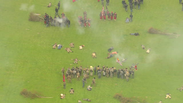 ms aerial shot of dead soldiers on ground and union soldiers retreat during civil war reenactment at port hudson battlefield / zachary, louisiana, united states - battlefield stock videos & royalty-free footage
