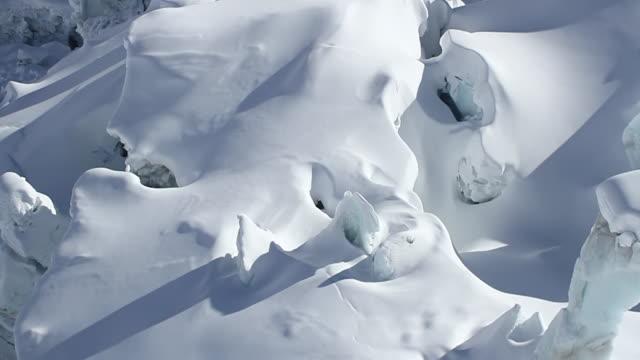 ws aerial tu shot of deep glacial crevasses, mont blanc / chamonix, haut savoir, france  - mont blanc stock videos & royalty-free footage