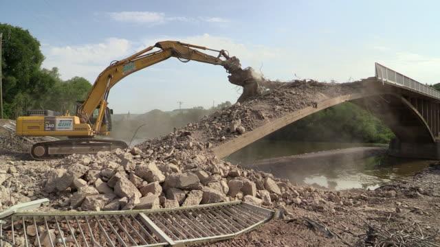 WS Shot of demolition of old bridge at Saar river / Wiltingen, Rhineland Palatinate, Germany