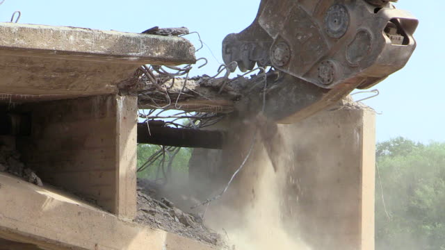 ms shot of demolition of old bridge at saar river / wiltingen, rhineland palatinate, germany - bulldozer stock videos & royalty-free footage