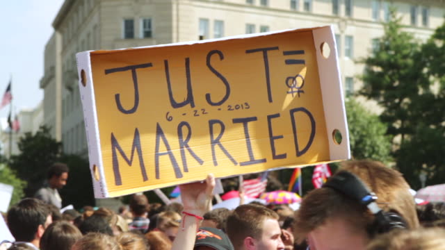 cu zo shot of demonstrators saying just=married sign during rally for marriage equality / washington, district of columbia, united states - just married stock videos and b-roll footage