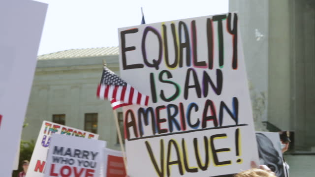 CU ZO Shot of demonstrators showing sign and saying EQUALITY IS AN AMERICAN VALUE at Supreme Court building / Washington, District of Columbia, United States