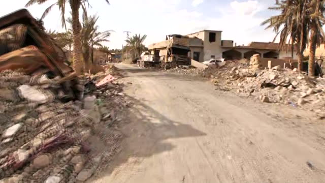 pov shot of destruction and debris in baghouz syria on march 22 2019 - (war or terrorism or election or government or illness or news event or speech or politics or politician or conflict or military or extreme weather or business or economy) and not usa stock videos & royalty-free footage