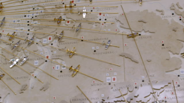 ms pan shot of detail of great air assault map on wall of cambridge american cemetery and memorial showing wartime europe and main bombing targets attacked by american and british aircraft / coton, cambridgeshire, united kingdom - d day stock videos and b-roll footage