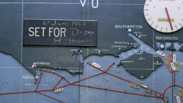 ms shot of detail of map plotting normandy invasion shows sign saying set for d day 6th june 1944 / portsmouth, united kingdom - d day stock videos and b-roll footage