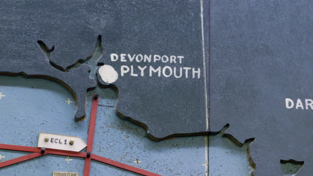 cu pan shot of detail of map plotting the normandy invasion on the english coast from dartmouth to plymouth / portsmouth, united kingdom - d day stock videos and b-roll footage