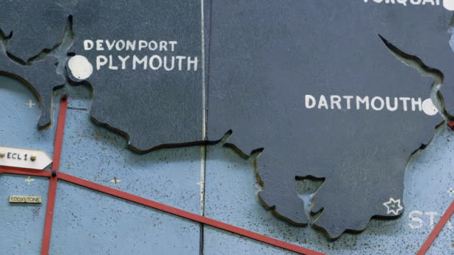 cu pan shot of detail of map plotting the normandy invasion on the english coast from fowey to plymouth to dartmouth / portsmouth, united kingdom - d day stock videos and b-roll footage