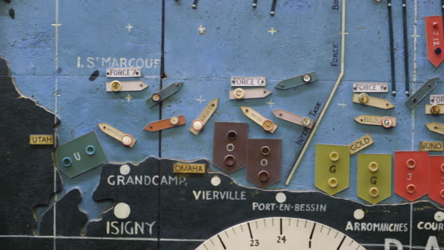 ms pan shot of detail of map plotting the normandy invasion shows several vessels heading for the coast of normandy / portsmouth, united kingdom - d day stock videos and b-roll footage
