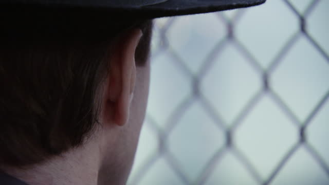 ECU R/F Shot of Detective looking at bridge / Philadelphia, Pennsylvania, United States