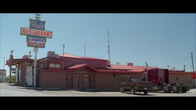 ms shot of diner in desert / unspecified - letterbox stock-videos und b-roll-filmmaterial