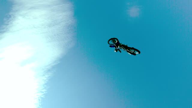 WS SLO MO LA TS Shot of dirt biker jumping over / Venice, California, United States