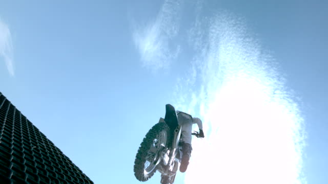 MS SLO MO LA Shot of dirt biker riding and jumping / Venice, California, United States