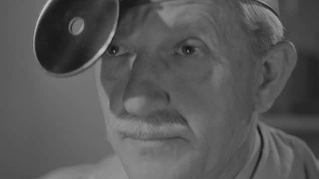 cu shot of doctor observing - black and white stock videos & royalty-free footage