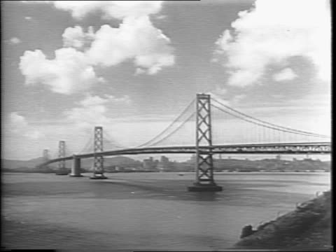 shot of document the charter of united nations / long shots of san francisco skyline golden gate bridge / narrator reads the united nations charter - narrating stock videos and b-roll footage