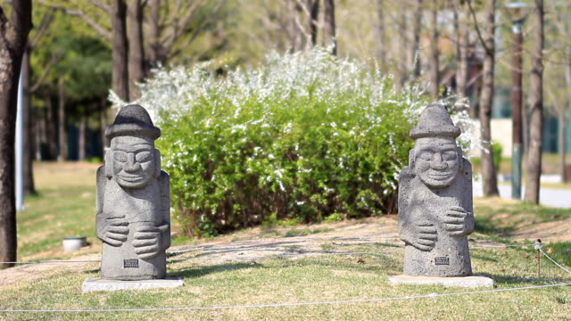 MS Shot of Dolharubang (The traditional stone statues of Jejudo in old man shape) / Jeju, Jeju, South Korea