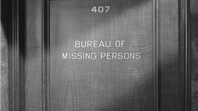 ms zi shot of door of bureau of missing persons  - missing persons stock videos & royalty-free footage