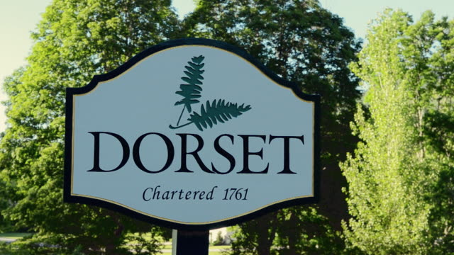 CU Shot of Dorset Vermont town welcome sign founding in 1761 / Dorset, Vermont, United States