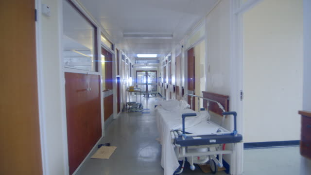 WS TS  Shot of Down hallway of delapidated hospital hallway / Leeds, West Yorkshire, United Kingdom