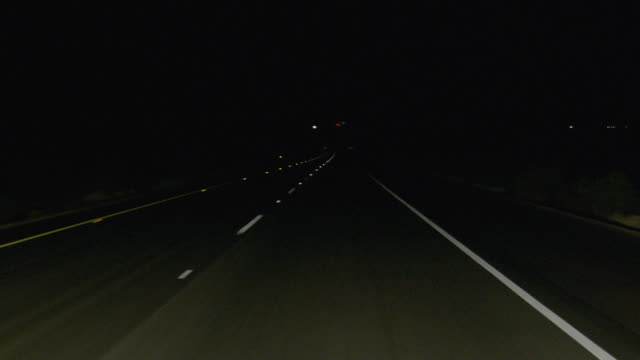 ms pov shot of down highway west interstate 40 - night stock videos & royalty-free footage