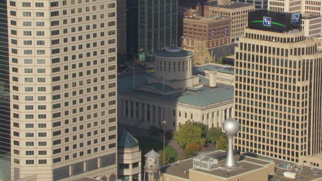 WS AERIAL Shot of downtown buildings and State House through skyscrapers / Columbus, Ohio, United States