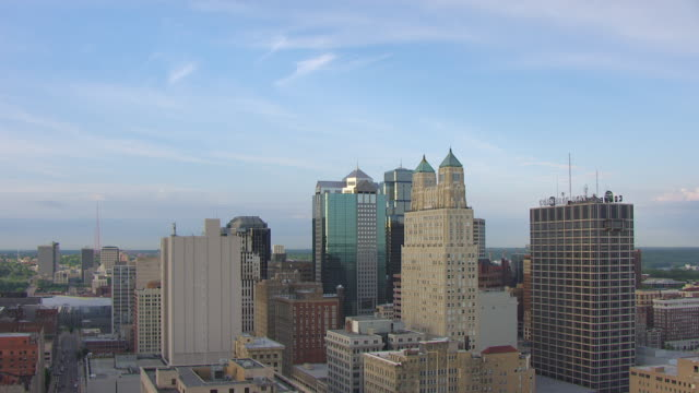 WS AERIAL DS Shot of downtown buildings in morning / Kansas City, Missouri, United States