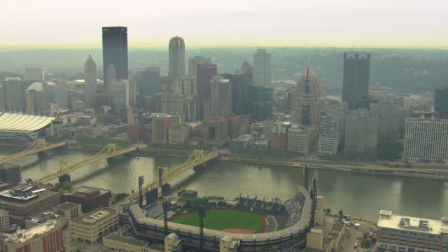 WS AERIAL Shot of downtown buildings with river / Pittsburgh, Pennsylvania, United States