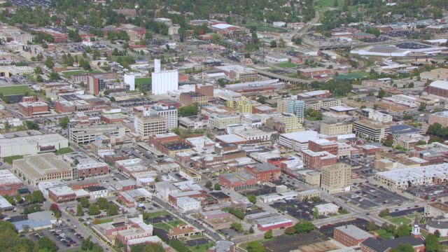 WS AERIAL Shot of downtown low rise buildings / Springfield, Missouri, United States