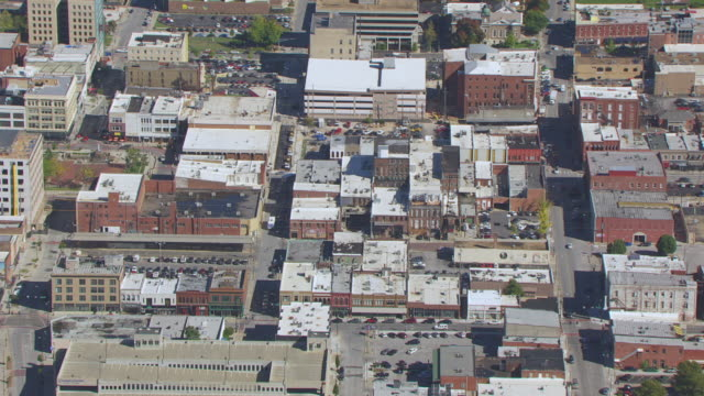 MS AERIAL Shot of downtown low rise buildings / Springfield, Missouri, United States