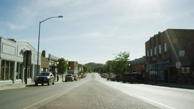 shot of downtown rawlins, wyoming from the middle of the street under a sunny sky - wyoming stock videos & royalty-free footage