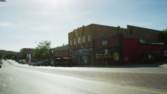 shot of downtown rawlins, wyoming under a sunny sky - wyoming stock videos & royalty-free footage
