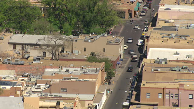 MS AERIAL TU Shot of downtown street with St Francis Roman Catholic Cathedral / Santa Fe, New Mexico, United States