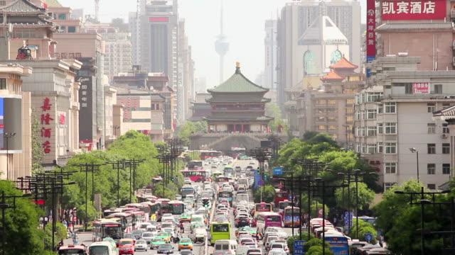 MS Shot of downtown traffic near bell tower / Xian, Shaanxi, china