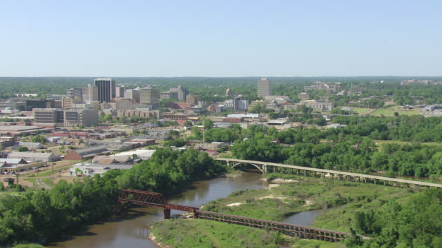 WS AERIAL Shot of downtown with highrise buildings and river / Jackson, Mississippi, United States