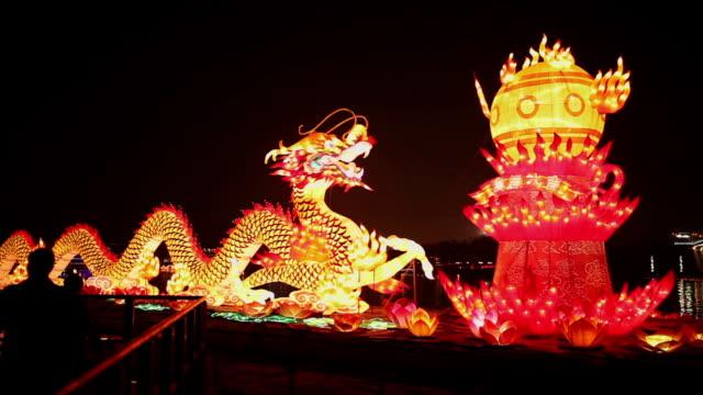 stockvideo's en b-roll-footage met ms pan shot of dragon lantern for celebrating spring festival / xian, china - chinees nieuwjaar