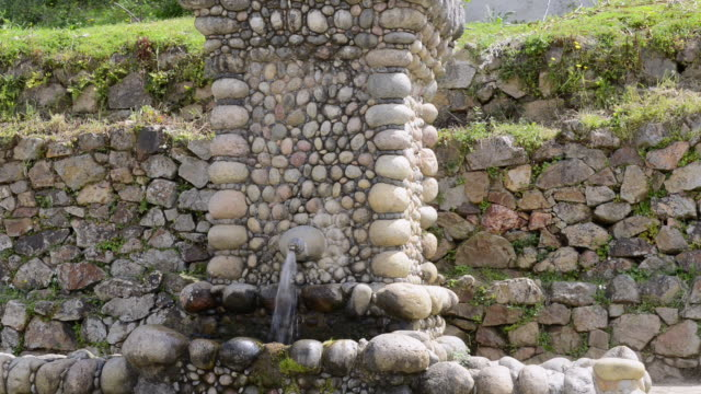 ws shot of drinking water from an old stone fountain / centuri port, corsica, france - halbnahe einstellung stock-videos und b-roll-filmmaterial