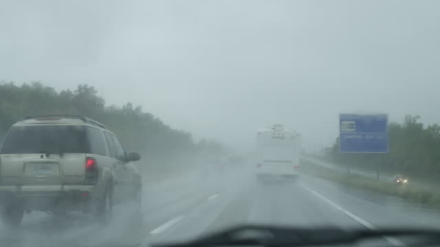 ms pov shot of driving on highway in rain / missouri, united states - midwest usa stock videos & royalty-free footage