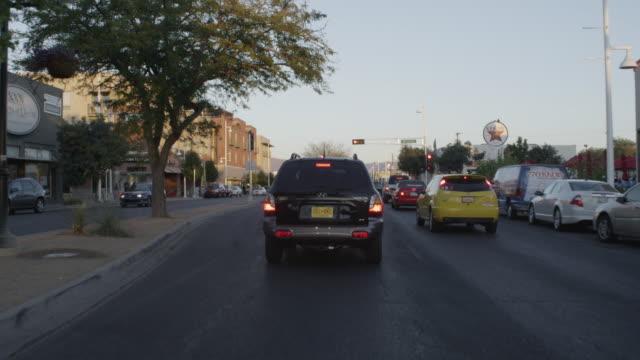 vídeos y material grabado en eventos de stock de ms pov shot of driving on route 66 in albuquerque / albuquerque, new mexico, united states - route 66