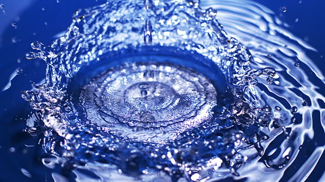 cu slo mo shot of drop of water falling into water / vieux pont en auge, normandy, france  - voll stock-videos und b-roll-filmmaterial