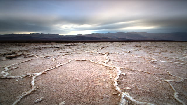 MS POV T/L Shot of Dry Cracked Earth / Death Valley NP, California, United States
