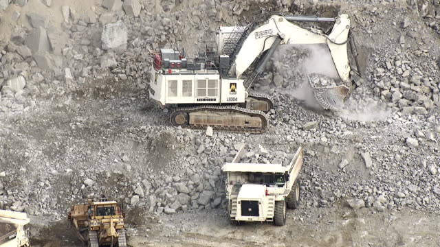 MS AERIAL Shot of dump truck being filled with rubble on opencast mine / Johannesburg, Gauteng, South Africa
