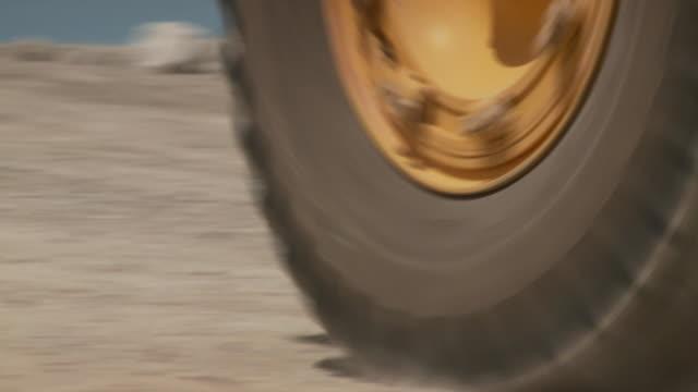 CU TU Shot of dump truck driving past / Namibia
