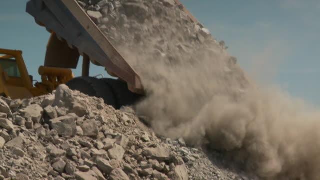 MS Shot of dump truck dumping its load / Namibia