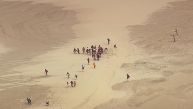 ws aerial shot of dune du pilat tallest sand dune / aquitaine, france - dune of pilat stock videos and b-roll footage