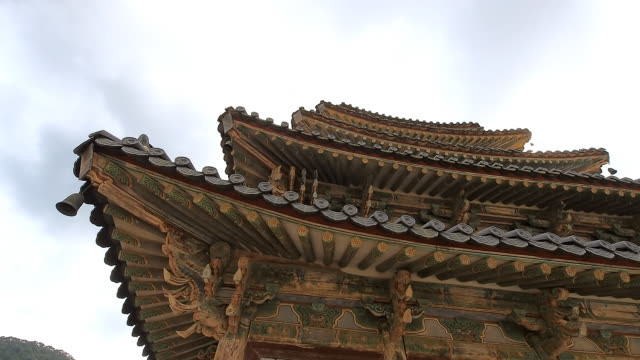 ms pan shot of eaves of palsangjeon at beopjusa(head temple of the jogye order of korean buddhism) / boeun, chungcheongbukdo, south korea - eaves stock videos and b-roll footage