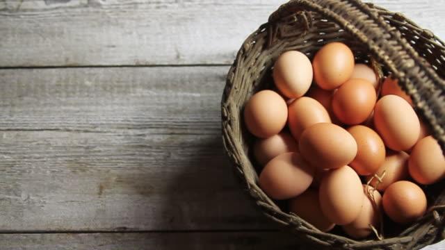ms pan shot of eggs in basket / london, united kingdom  - basket stock videos & royalty-free footage