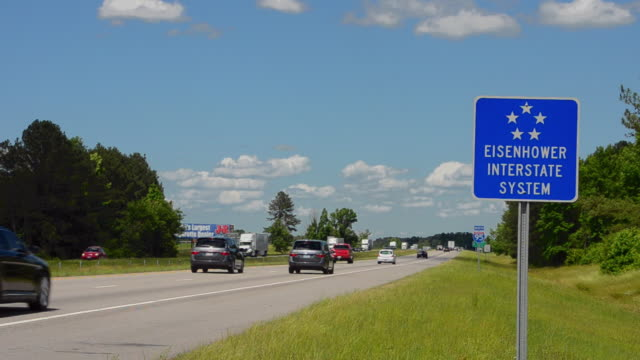 ms shot of eisenhower interstate system sign of north carolina of i-95 super highway with traffic / north carolina, united states - autostrada interstatale americana video stock e b–roll