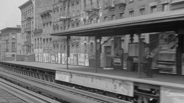 WS POV Shot of El Train moving through tenement district