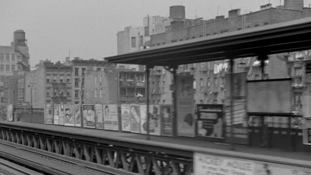 ws pov shot of el train moving through tenement district   - elevated train stock videos and b-roll footage